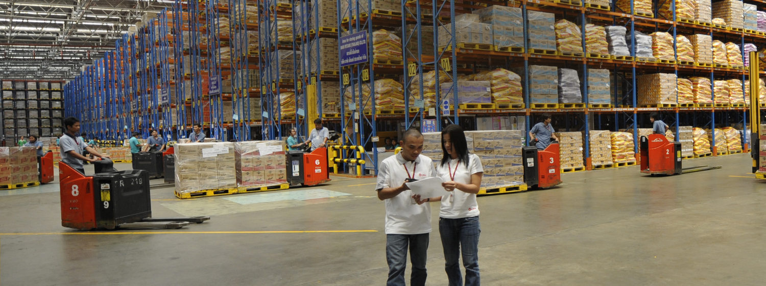one boy and girl standing in warehouse